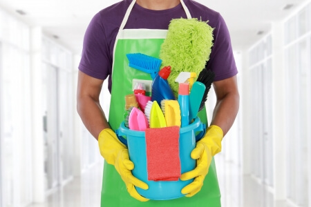 Clean Bathrooms image with man holding tools for cleaning