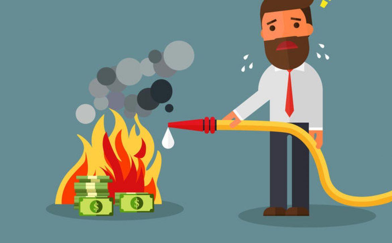 84411170 - businessman fighting fire burning money